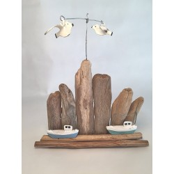 Pair Of Tugs On Driftwood With Flying Seagulls